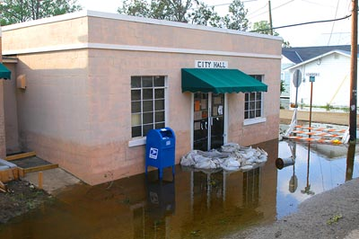 Delcambre, LA, September 25, 2005: The town's city hall, once under two feet of water, shows evidence of an attempt to sandbag the water out of the structure. Public facilities were among the many buildings flooded by Hurricane Rita. Photo taken by Win Henderson / FEMA.