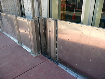 Flood Panel - flood barriers at Armani Exchange, Miami Beach, Florida.
